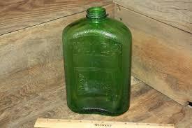 green glass water bottle fridge water