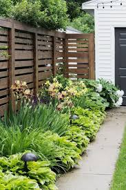 Decorating The Look Of Your Front Yard Is One Way To Create A Space That Reflects Your Side Yard Landscaping Privacy Fence Landscaping Cheap Landscaping Ideas