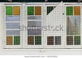 coloured glass panes covering mesh