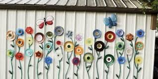 garden hose and plate outdoor art idea