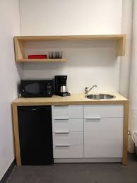 Pin by Adela Hill on Microwave in cabinet | Kitchenette design ...