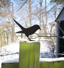 bird seeks worm garden ornament yard art