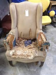 it cost to reupholster a chair