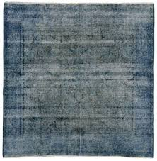distressed overdyed blue persian rug