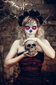 attractive young woman with sugar skull