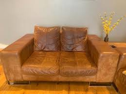 distressed brown leather sofas in