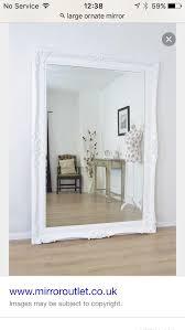 large floor standing ornate mirror