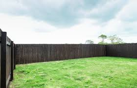 How To Stain A Fence With A Stain Sprayer Wagner Diy Projects In 2020 Small Backyard Raised Garden Beds Elevated Garden Beds