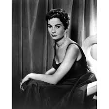 Shop Jean Simmons Seated on a Couch in Black Velvet Strap Dress ...