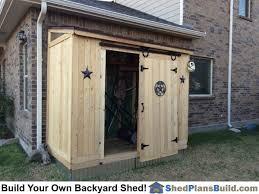 backyard storage shed with barn door