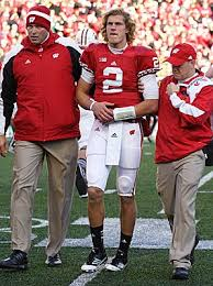 Quarterback Joel Stave is helped off the field after breaking his  collarbone against Michigan State. Photo by Patrick S B… | Football,  College football, Quarterback