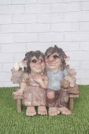 gnome couple sitting on garden bench