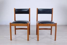 leather and wood dining chairs from isa