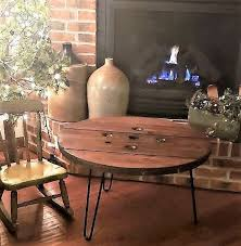 20 30 round stained wood spool tables