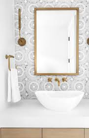 bathroom features a brass