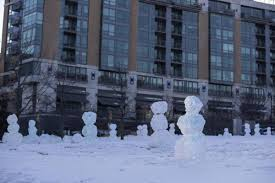 They're back! Dyed snowmen dubbed the 'Love Army' have returned — this time  in Turner Park | Local News | omaha.com