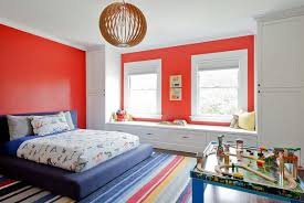Kids Bedroom With Red Walls And A Colorful Striped Rug Hgtv