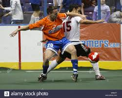 Baltimore Blast's Adauto Neto (R) battles St. Louis Steamers Jeff DiMaria  for possession of the ball during the first quarter of their MISL game at  the Savvis Center in St. Louis on