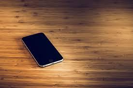 apple desk iphone mobile phone