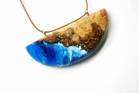 wood and resin jewelry resembles an