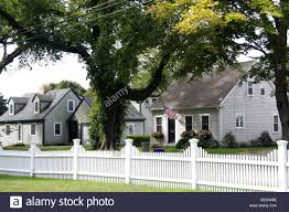 Cape Cod Homes And White Picket Fence Falmouth Cape Cod New Stock Photo Alamy