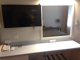 flat screen tv mirror and deskarea