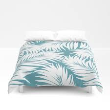 palm tree fronds white on soft blue