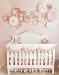 a pink and gold nursery for baby everly