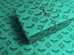 head moth on teal gothic wrapping paper