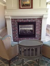 brick fireplaces with white surround