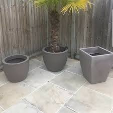 3 large grey garden planters pots in