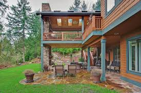 two level covered deck rustic patio