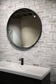 round mirror w composite stone frame