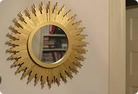metallic gold sunburst mirror from wood