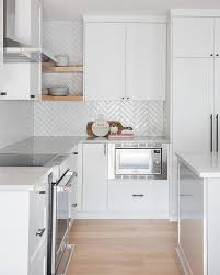 glossy white herringbone kitchen tiles
