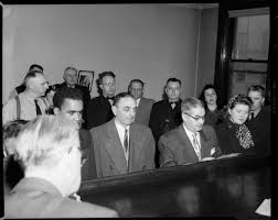 Shooting suspect Lawrence Robinson, detective Clem Bartirome, detective  inspector Adam Geisler, and shooting victim Janet Mackrell, standing at  judge's bench in Morals Court, Allegheny County Courthouse | CMOA Collection