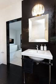 a large black framed floor mirror and