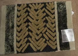 accent or bath rug black or multi