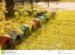 Fallen Yellow Leaves And Multicolor Homemade Fence Lawn Fall Season Stock Photo Image Of Tires Fence 63342978