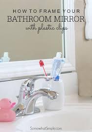 bathroom mirror over plastic clips