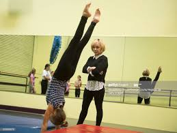 Cathy Rigby watches student Ava Hansen during an acro tumbling class...  News Photo - Getty Images