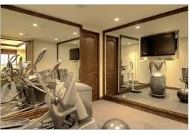 the flat screen tv in this home gym