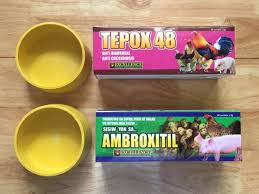 Tepox 48, Ambroxitil and Yellow Rubber Feeder was shipped to Temple Texas  USA via DHL Waybill Number 2350160186 | Gamecock Apparel And Supplies