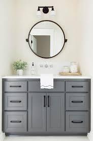 round oil bronze pivot mirror