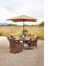 marsala umbrella with dining table and