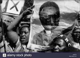 Demonstrator holds up poster of Bishop Abel Muzorewa, opposition Stock  Photo - Alamy