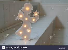 Christmas Angel With Lamps On Dark White Background Nightlight In The Shape Of Angel In The