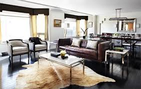 living rooms adorned with cowhide rugs