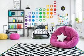 White Star Pillow On Pink Pouf In Colorful Child S Bedroom With Stock Photo Picture And Royalty Free Image Image 97990227