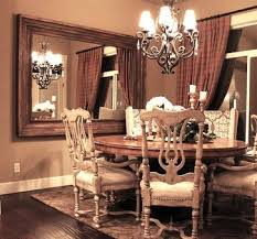 large wood framed mirror mounted on the